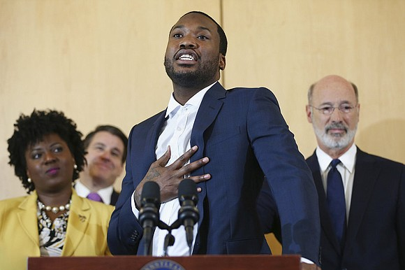 Just one week after a court ordered his immediate release from prison, Philadelphia-born rapper Meek Mill joined Pennsylvania's governor on ...