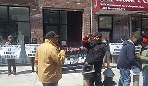 Protesters organize in front of a new building in Bed-Stuy, Brooklyn