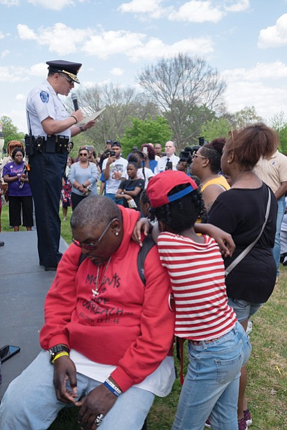 The event was designed to show support for families whose loved ones are missing and provide tools to the community to stay safe. Below left, members of Friends for Farrakhan pick up information about Ms. Jacobs, while Richmond Police Chief, at left, Alfred Durham addresses the crowd.