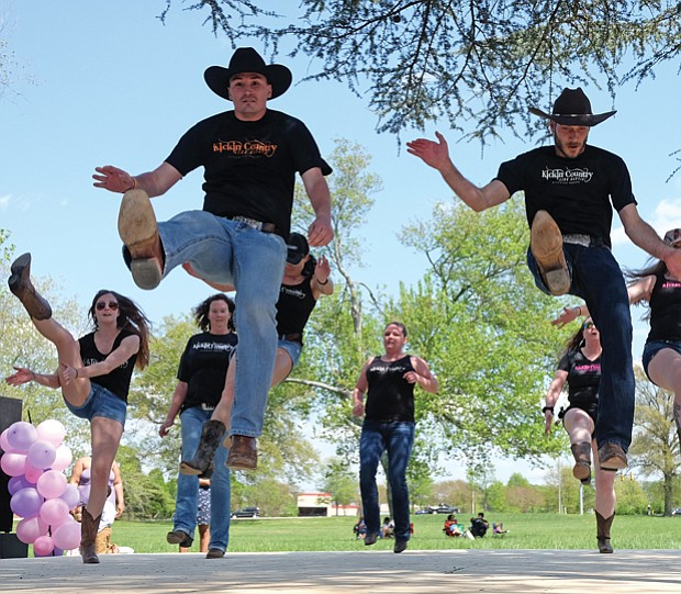 The free event, held on the grounds at St. Joseph's Villa in North Side, featured all forms of music and dance. Above right, high steppers from Kickin' Country show off their moves