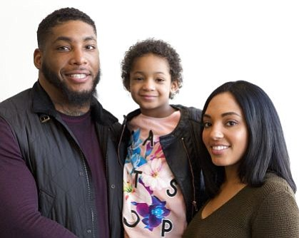 In this April 12, 2016, file photo, former Houston Texans defensive end Devon Still and his fiancee Asha Joyce pose with their daughter, Leah, 5, in New York. Still retired from football and started his second career, trying to help families cope with childhood cancer. He's using lessons learned through his experience with 7-year-old daughter Leah, who became a national story during her recovery from the disease. (AP Photo/Mark Lennihan, File)