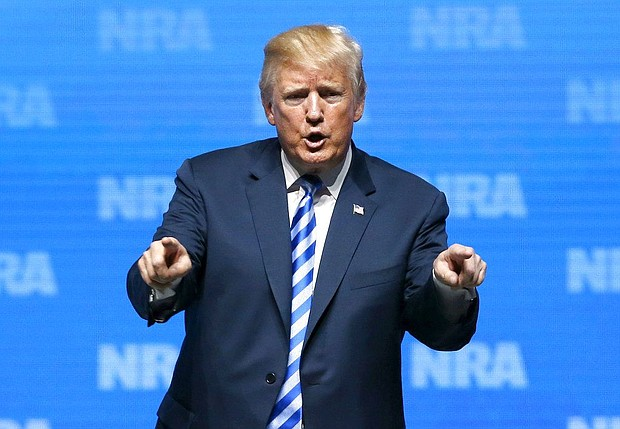 President Donald Trump gestures to the audience after speaking at the National Rifle Association annual convention in Dallas, Friday, May 4, 2018. (AP Photo/Sue Ogrocki)