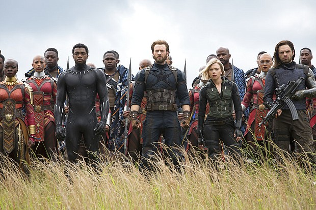"Front row from left, Danai Gurira, Chadwick Boseman, Chris Evans, Scarlet Johansson and Sebastian Stan in a scene from ""Avengers: Infinity War."" (Chuck Zlotnick/Marvel Studios via AP)"