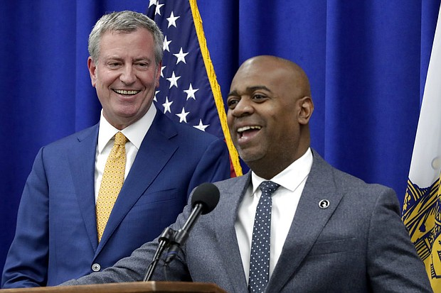 New York City Mayor Bill De Blasio, left, looks on as Newark Mayor Ras Baraka speaks during a news conference announcing a proposed ordinance to provide low income residents with access to free legal representation in landlord-tenant disputes, Tuesday, May 1, 2018, in Newark, N.J. (AP Photo/Julio Cortez)