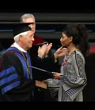 Shirl Baker got a standing ovation as she accepted the college diploma of her daughter, DeEbony Groves, one of four people killed in a Tennessee Waffle House in April. Groves' brother Di'Angelo also graduated from Belmont University in Nashville. (Screen grab/AP video)