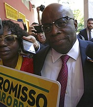 In this April 19, 2018 photo, former Supreme Court President Joaquim Barbosa, the first black member of the country's top court, arrives for a meeting with the leaders of the Brazilian Socialist Party to be named one of their candidates for president in Brasilia, Brazil. (AP Photo/Eraldo Peres, File)