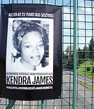 A portrait of the late Kendra James goes up as part of a makeshift memorial created over the weekend on the North Skidmore Street overpass above I-5. It marked the 15th anniversary of the fatal police shooting of the unarmed 21-year-old Portland woman during a traffic stop.