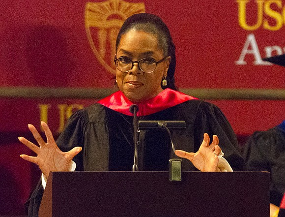 Oprah Winfrey paused before talking politics Friday as she stood in front of a crowd of graduates at the University ...