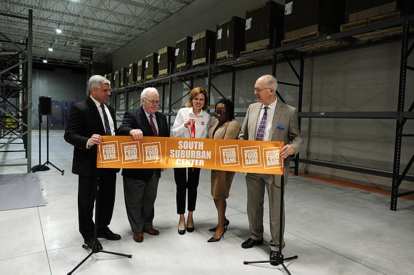 Nearly 200 community members and supporters of Northern Illinois Food Bank joined in a public grand opening and ribbon cutting ...