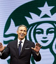 Starbucks CEO Howard Schultz speaks at the Starbucks annual shareholders meeting in Seattle. Schultz says the company will now allow people to use bathrooms at its coffee shops even if they don't buy anything, as it continues to take a closer look at its operations following the arrest of two black men at a Philadelphia shop.  (AP Photo/Elaine Thompson, File)
