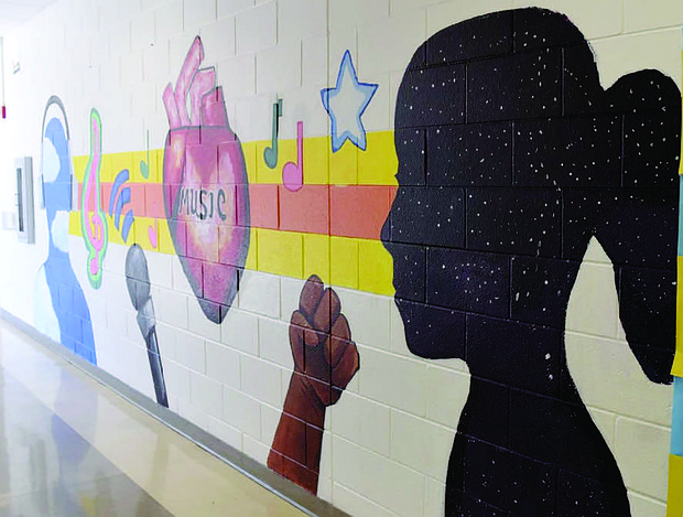 A mural, titled The Art of Music, was a collaborative effort between Ricardo Gonzalez, an artist and resident of Blue Island, students from Kellar Middle School in Robbins, Metropolitan Family Services, and the Blue Island-Robbins Neighborhood Network.