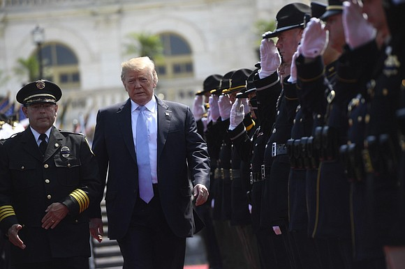 "President Donald Trump honored on Tuesday the sacrifices of police officers killed in the line of duty, calling them ""among ..."
