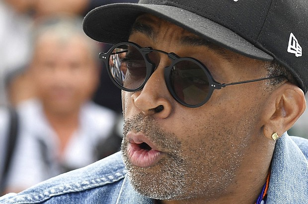 Director Spike Lee pose for photographers during a photo call for the film 'BlacKkKlansman' at the 71st international film festival, Cannes, southern France, Tuesday, May 15, 2018. (Photo by Arthur Mola/Invision/AP)