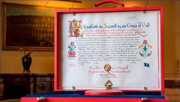 An image of Queen Elizabeth II's elaborate notice of consent to the marriage of Prince Harry and Meghan Markle was ...