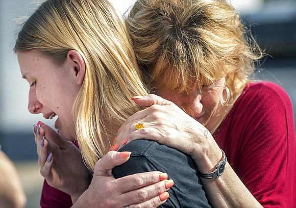 A 17-year-old carrying a shotgun and a revolver opened fire at a Houston-area high school Friday, killing 10 people, most ...