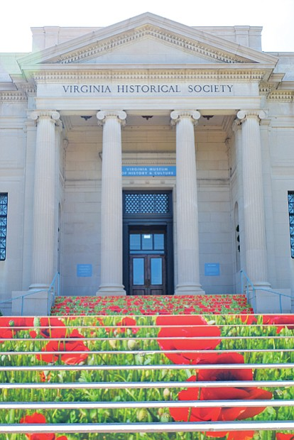 "A pop of color // A field of colorful printed poppies decorates the front steps of the Virginia Museum of History and Culture. Location: 428 N. Boulevard. The red flowers, known as remembrance poppies, are designed to call attention to the World War I America exhibition on display at the museum through July 29. Poppies have long been a memorial symbol for those who died in that war. Described as the largest traveling exhibition of its kind, the display includes items ranging from President Woodrow Wilson's hat and cane to escape artist Harry Houdini's handcuffs along with photos, helmets, gas masks and other items. The Richmond museum is the only East Coast venue hosting the exhibition this year. The museum plans to keep the poppy field, printed on ""brick vinyl"" material, on its steps until Nov. 11, 2018, when the nation and the world will mark the 100th anniversary of the conflict's end."
