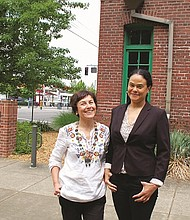 "Laura Lo Forti (left) and Damaris Webb, co-organizers of the Vanport Mosaic Festival, pose outside the Interstate Firehouse Cultural Center on North Interstate Avenue, showcasing one of the primary event venues for the annual celebration taking place this long Memorial Day weekend on the 70th anniversary of the Vanport Flood. The IFCC will host several exhibitions, like Vanport: The Surge of Social Change; Anywhere but Here: The History of Housing and Discrimination in Oregon; and Our City, Our Voice: Excavating Portland's History through Art. A new play about displacement in Portland, ""Left Hook,"" will also make its world premiere at the IFCC on Thursday."