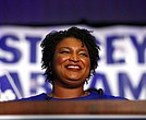 Democratic candidate for Georgia Governor Stacey Abrams smiles as she speaks during an election-night watch party Tuesday, May 22, 2018, in Atlanta. (AP Photo/John Bazemore)