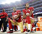 "In this Monday, Sept. 12, 2016, file photo, San Francisco 49ers safety Eric Reid (35) and quarterback Colin Kaepernick (7) kneel during the national anthem before an NFL football game against the Los Angeles Rams in Santa Clara, Calif. NFL owners have approved a new policy aimed at addressing the firestorm over national anthem protests, permitting players to stay in the locker room during the ""The Star-Spangled Banner"" but requiring them to stand if they come to the field. (AP Photo/Marcio Jose Sanchez, File)"