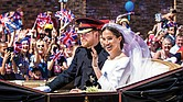 Prince Harry and Meghan Markle wave to a cheering crowd from their horse-drawn carriage after their wedding ceremony last Saturday in St. George's Chapel in Windsor, England.