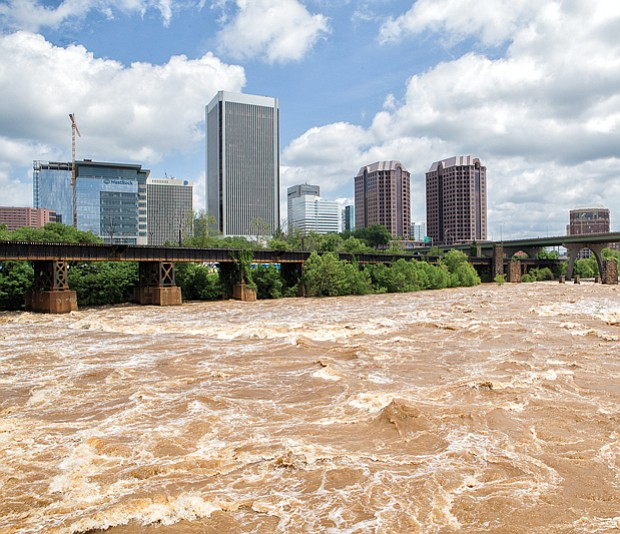 The waters of the James River rage through Richmond on Monday, fueled by fives days of heavy rain last week. During the weekend, the river crested 3 feet above the 8-foot flood stage in Downtown before returning to its banks this week. 