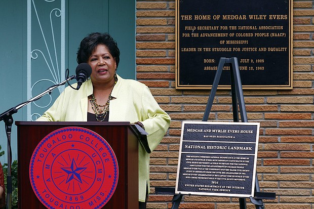 Reena Evers-Everett, daughter of civil rights leaders Medgar and Myrlie Evers, delivers reflections on behalf of her family before the National Park Service presented a bronze plaque, right, showing the Jackson, Miss., Evers' home as a national historic landmark, Thursday, May 24, 2018. (AP Photo/Rogelio V. Solis)
