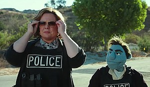 "Melissa McCarthy with her puppet co-star in ""The Happytime Murders."""