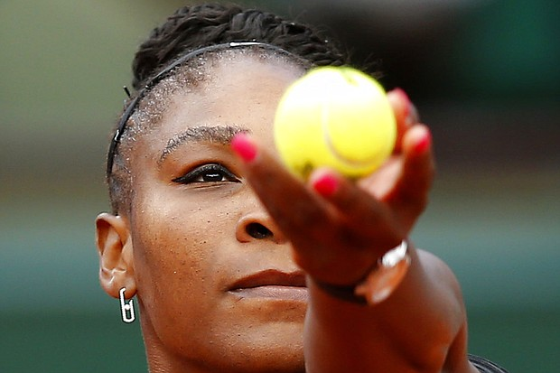 Serena Williams serves against Krystina Pliskova of the Czech Republic during their first round match of the French Open tennis tournament at the Roland Garros stadium in Paris, France, Tuesday, May 29, 2018. (AP Photo/Michel Euler)