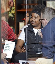 People are seen meeting inside the ground floor, closed Starbucks Reserve at the company's headquarters during employee anti-bias training, Tuesday, May 29, 2018, in Seattle. (AP Photo/Elaine Thompson)