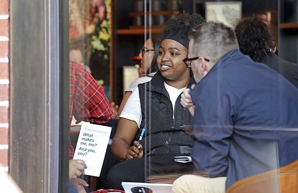 Starbucks, mocked three years ago for suggesting employees discuss racial issues with customers, asked workers to talk about race with ...