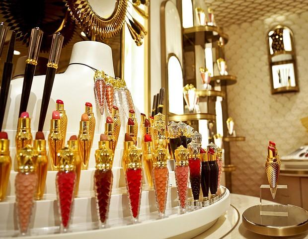 Cosmetic products are displayed inside the new Christian Louboutin space at the revamped second floor devoted to beauty at Saks Fifth Avenue in New York. Department stores are being forced to rethink how they sell higher-end makeup and perfume as competition intensifies from discounters like Target, specialty chains like Sephora and Ulta and online brands. (AP Photo/Bebeto Matthews)
