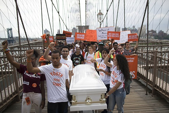 Thousands of demonstrators have marched across New York's Brooklyn Bridge in a protest against gun violence.