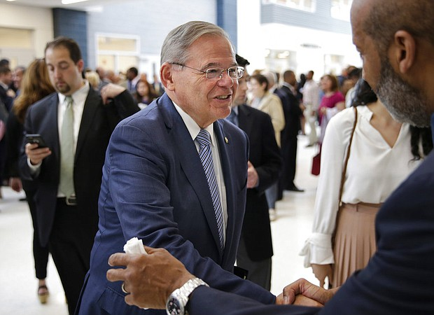 New Jersey Sen. Bob Menendez greets people at a ribbon cutting ceremony at Essex County Donald M. Payne, Sr. School of Technology in Newark, N.J., Monday, June 4, 2018. (AP Photo/Seth Wenig)