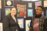 Washington 7th grade student Anderson Tucker is shown by his art with Washington art teacher Rachel Vische.