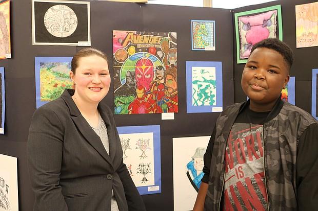 Washington 7th grade student Anderson Tucker is shown by his art with Washington art teacher Rachel Vische.