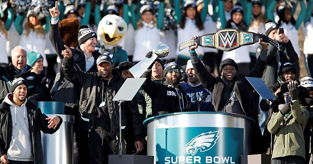 Malcolm Jenkins holding the Super Bowl Trophy at a February Celebration, and his Philadelphia Eagles teammates decline Donald Trumps invitation to the White House
