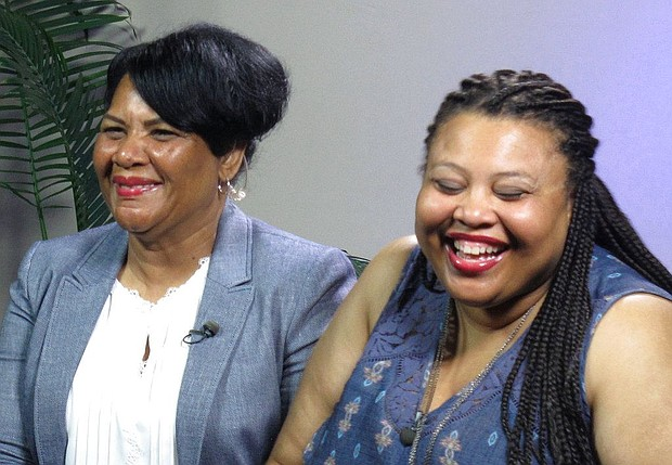 """Alice Marie Johnson, left, and her daughter Katina Marie Scales wait to start a TV interview on Thursday, June 7, 2018 in Memphis, Tenn. Johnson, 63, whose life sentence was commuted by President Donald Trump thanked him for """"having mercy"""" and said reality TV star Kim Kardashian West saved her life. (AP Photo/Adrian Sainz)."""