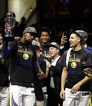 Golden State Warriors' Kevin Durant, second from left, celebrates after the Warriors defeated the Cleveland Cavaliers 108-85 in Game 4 of basketball's NBA Finals to win the NBA championship, Friday, June 8, 2018, in Cleveland. (AP Photo/Tony Dejak)