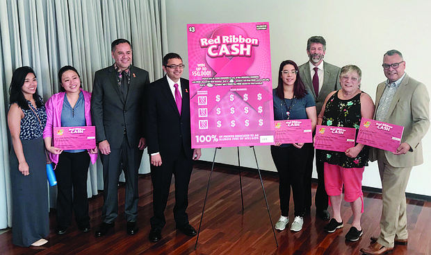 The Illinois Lottery along with the Illinois Department of Public Health recently announced the 11 Illinois agencies that will be receiving grants to fund HIV/AIDS research, treatment and prevention programs across the state. The grants range from $50,000 to $75,000 and are made possible from Illinois Lottery's Red Ribbon Cash instant ticket. Photo: Katherine Newman
