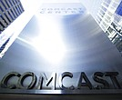 This file photo shows a sign outside the Comcast Center in Philadelphia. (AP Photo/Matt Rourke, File)