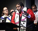 In this April 2, 2018 file photo, Rev. Dr. William J. Barber II, center, and Rev. Dr. Liz Theoharis, left, co-chairs of the Poor People's Campaign, speak at the National Civil Rights Museum in Memphis, Tenn. (AP Photo/Mark Humphrey)