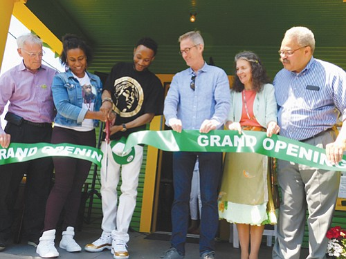 Nicole Kennedy and Karanja Crews cut the ribbon for the grand opening of the world's first hip-hop themed cannabis dispensary near Northeast 16th and Killingsworth, drawing support from local government leaders promoting equity in the licensing of operators and for employment in Oregon's new recreational marijuana industry. Also pictured at Saturday's event are (from left) Oregon Congressman Earl Blumenauer, Portland Mayor Ted Wheeler, City Commissioner Amanda Fritz and State Sen. Lew Frederick.