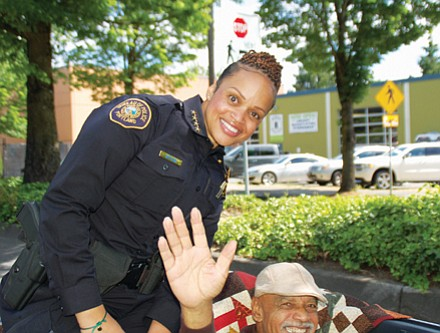 Police Chief Danielle Outlaw, the first African American female police chief in Portland history, was grand marshal of the Juneteeth parade. She is pictured atop a convertible with her father.