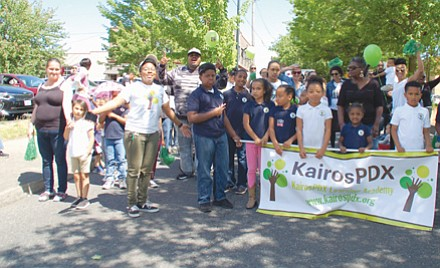 Students, staff, and parents of KairosPDX elementary school march proudly for Saturday's Juneteenth parade.