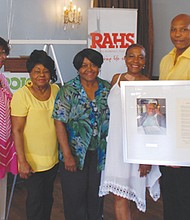 Rosemary Anderson High School Principal Joe McFerrin (right) presents a proclamation to the family of  Pearl Smothers Mashia, honoring the late and beloved attendance secretary for her 22 years at the school. Attending the ceremony last Wednesday were (from left) Linda Mashia-Jones, Donna Jean Harris, Pearl Thomas, Anita Craig, Lucy Mashia and Eric Mashia.