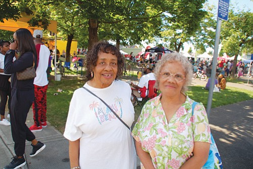 Portlanders Jeanette Carr (left) and Mildred Tarver at the bustling King School Park grounds for the 2018 festival.