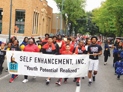 Educational non-profit Self-Enhancement Inc. marches down Martin Luther King Blvd. for the annual Good in the Hood Festival parade.