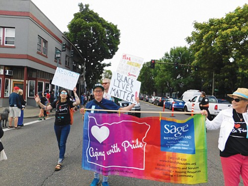 Services and Advocacy for Gay, Lesbian, Bisexual, & Transgender Elders, march with pride for the Good in the Hood parade.