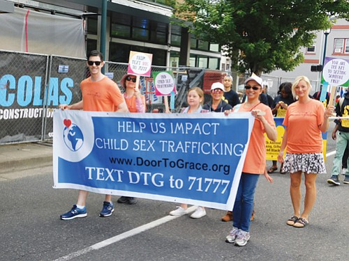 Non-profit Door-To-Grace, an organization helping to cease child sex trafficking, shows out for the parade.