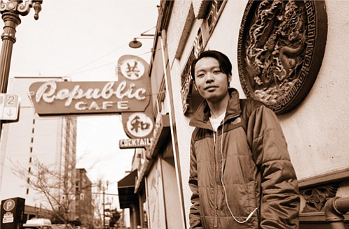 One of the photographs for the inaugural opening exhibit for the Portland Chinatown Museum shows Ivan Mui in front of the Mui family-owned Republic Café in downtown Portland.